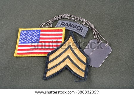 KIEV, UKRAINE - August 21, 2015.  US ARMY Sergeant rank patch, ranger tab, flag patch and dog tag on olive green uniform
