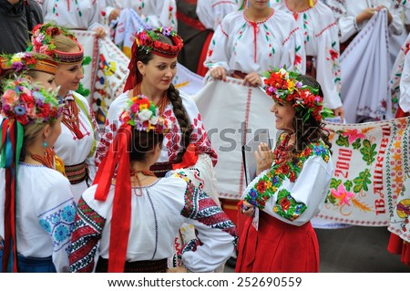 KIEV, UKRAINE - AUGUST 24: Young and beautiful ladies in national embroided shirts at All Ukrainian Vyshyvanka Parade at Independence Day on August 24, 2013