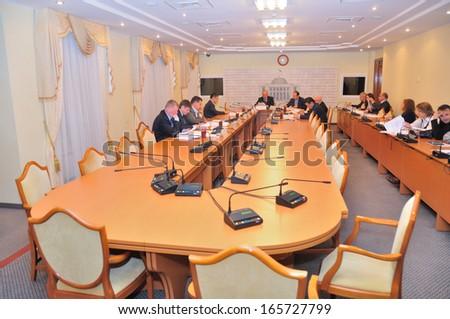 KIEV, UKRAINE � CIRCA OCTOBER 2013: Unknown deputies in the committee of Ukrainian parliament discuss laws CIRCA October 2013 in Kiev, Ukraine. - stock photo