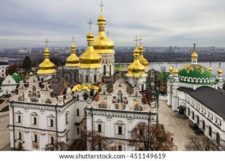 Kiev, Ukraine. Cupolas of Pechersk Lavra Monastery and river Dniepr - stock photo