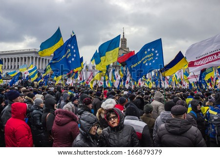 KIEV, UKRAINE, DEC 8, 2013: People and flags at the meeting for the European integration and the resignation of the government in the center of Kiev. - stock photo