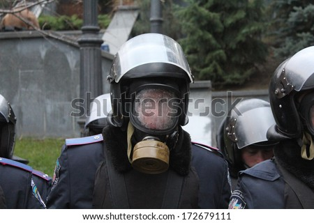 KIEV, UKRAINE -Â?Â? DEC 1, 2013: Police officer stands near Presidential Administration during massive protests in Independence Square on Dec 1, in Kiev, Ukraine. He has condensate inside his helmet. - stock photo
