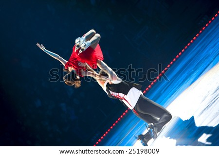 KIEV, UKRAINE – DEC 24: Skating pair Alex Tikhonov & Maria Petrova perform during the Ice Period show at Palace of Sport on December 24, 2007 in Kiev, Ukraine. - stock photo