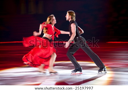 KIEV, UKRAINE – DEC 24: Skating pair Margarita Drobiazko & Povilas Vanagas perform during the Ice Period show at Palace of Sport on December 24, 2007 in Kiev, Ukraine.