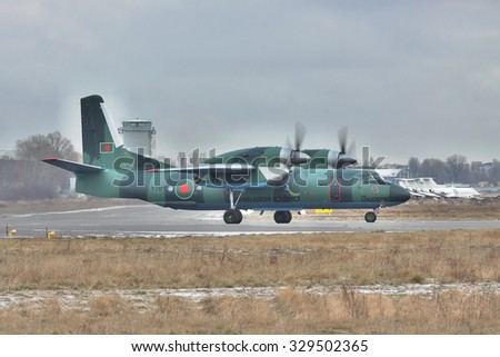 Kiev, Ukraine - December 24, 2011: Bangladesh Air Force cargo plane An-32 taxiing to take off