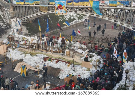 KIEV, UKRAINE - DECEMBER 14: Demonstrators guard EuroMaidan barricades on Institutska street during peaceful protests against Ukrainian president and government on December 14, 2013 in Kiev, Ukraine. - stock photo