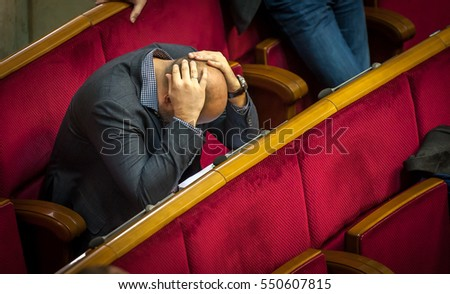 KIEV, UKRAINE - December 21, 2016: deputies of Verkhovna Rada during session. Parliament approved the country's state budget for 2017. MPs are sleeping in Conference Room of the Ukrainian Parliament