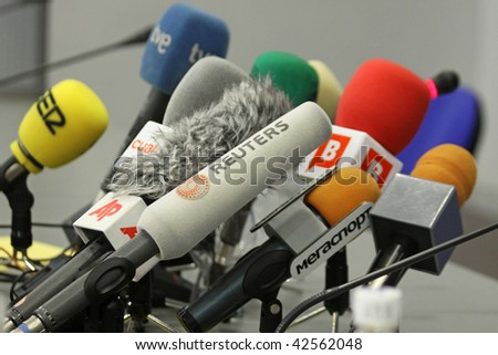 KIEV, UKRAINE - DECEMBER 8: Microphones on a table during press-conference before UEFA Champions League football match between Dynamo Kyiv and FC Barcelona on December 8, 2009 in Kiev, Ukraine. - stock photo