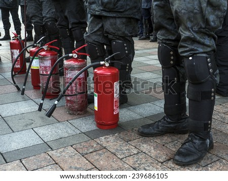 KIEV, UKRAINE - December 23, 2014: National Guard of Ukraine is ready to extinguish the tires, which promised to set fire to the protesters. - stock photo
