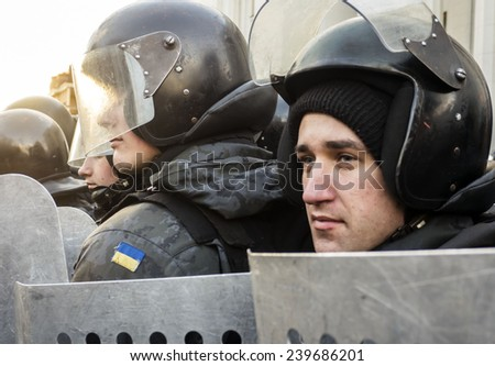 KIEV, UKRAINE - December 23, 2014: National Guard protects law and order near the Verkhovna Rada. -- To break through the cordon of police and four special forces in full uniform - stock photo