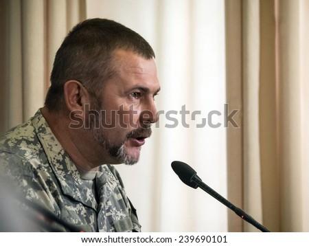 "KIEV, UKRAINE - December 23, 2014: People's deputy commander of the volunteer battalion ""Dnepr 1"" Yuri Bereza - stock photo"