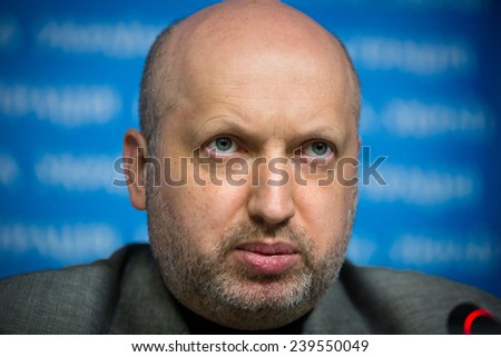 KIEV, UKRAINE  - DECEMBER 20, 2014: Secretary of the National Security and Defence Council of Ukraine Oleksandr Turchynov holds a breefing after ending of a meeting of NSDC - stock photo