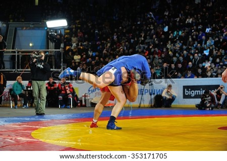 KIEV, UKRAINE - DECEMBER, 16, 2015: Ukrainian Combat Games III - nationwide Combat Games - fight of Ukrainian sambo-athletes for the Champion title - stock photo