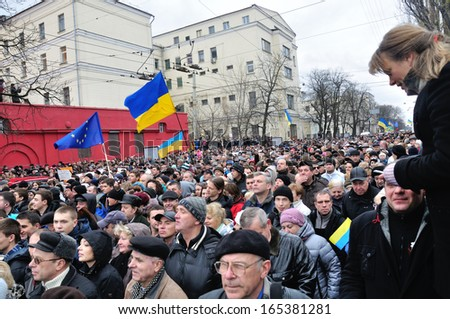 KIEV, UKRAINE � 1 DECEMBER 2013: Unknown demonstrators march on a revolution against the Ukrainian government after dispersal of proeuropean meeting on December 1, 2013 in Kiev, Ukraine.