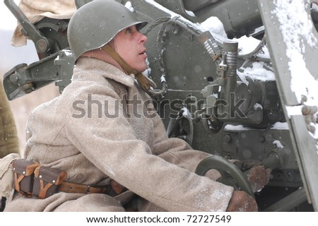 KIEV, UKRAINE - FEB 20: A member of military history club Red Star wears historical Soviet uniform during historical reenactment of WWII,February 20, 2011 in Kiev, Ukraine