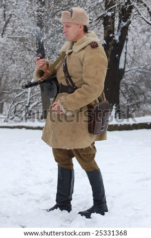 KIEV, UKRAINE - FEB. 20: A member of the history club called Red Star wears a historical Soviet uniform as he participates in a WWII reenactment. February 20, 2009 in Kiev, Ukraine.