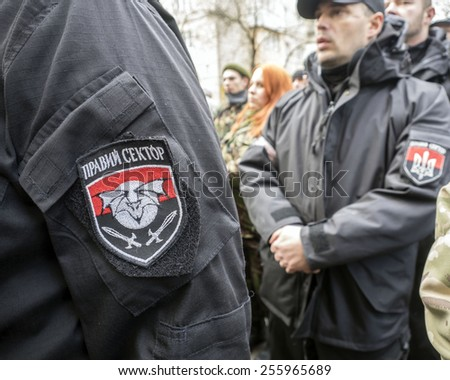"KIEV, UKRAINE - Feb 25, 2015: Chevron ""Right Sector"" on the sleeve of volunteer -- Ukrainian radical organization ""Right Sector"" held  ""Truth Marsh - Marsh rights.""  - stock photo"