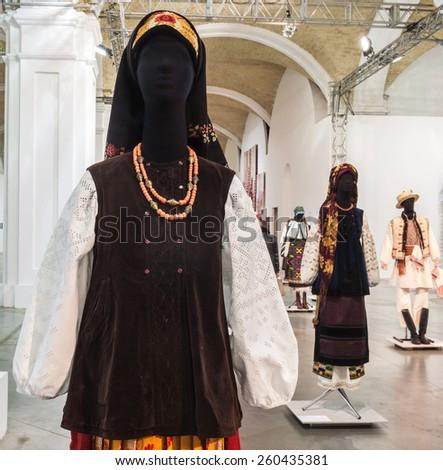 "KIEV, UKRAINE-FEB.17, 2015: 5 Feb.-1 March 2015 cultural complex ""Art Arsenal"" held intermuseum artproject ""Windows"" in which 100 exhibited Ukrainian complexes of clothing of Ukraine, Kiev, Ukraine. - stock photo"