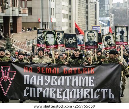 "KIEV, UKRAINE - Feb 25, 2015: Marsh ""Right Sector"" in downtown Kiev. -- Ukrainian radical organization ""Right Sector"" held  ""Truth Marsh - Marsh rights.""  - stock photo"