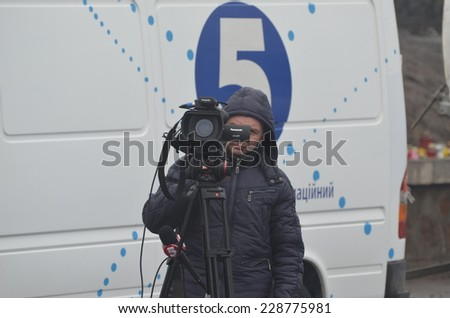 KIEV, UKRAINE - FEB 11, 2014:.TV operator of the 5-th Chanel of putsch leader Peter Poroshenko during anti-government protest.  Putsch of Junta in Kiev. February 11, 2014 Kiev, Ukraine  - stock photo