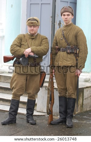 KIEV, UKRAINE - FEB 20: Two members of a history club called Red Star wears a historical Soviet uniform as he participates in a WWII reenactment in Kiev, Ukraine February 20, 2009.
