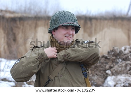 KIEV, UKRAINE -FEB 25: Unidentified member of Red Star history club wears historical American uniforms  during historical reenactment of WWII,Military history club Red Star on February 25, 2012 in Kiev, Ukraine