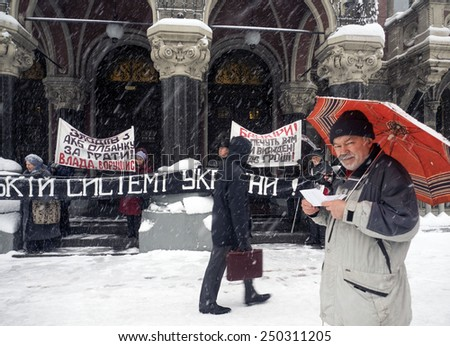 KIEV, UKRAINE - February 5, 2015: Activists of the NGO 'Association for the Protection of the rights of depositors' picket National Bank of Ukraine - stock photo