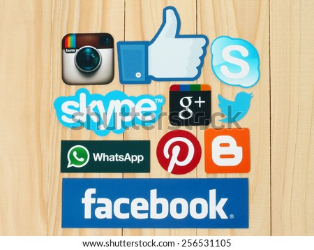 KIEV, UKRAINE - FEBRUARY 19, 2015:Collection of popular social media logos printed on paper:Facebook, Twitter, Google Plus, Instagram, Skype, WhatsApp, Pinterest and Blogger on wooden background - stock photo