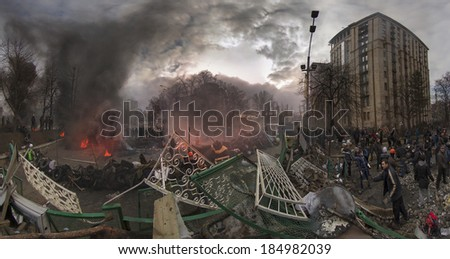 Kiev, Ukraine - February 20, 2014: Freed from government troops Evromaydan. View from the barricades. The smoke protesters hiding from snipers. Kiev, the capital defenders