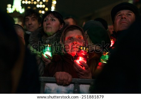 Kiev, Ukraine - 22 February 2014: People attend the funeral ceremony at Independence Square for anti-government protesters who were killed during protests in downtown Kiev, Ukraine, 22 February 2014.  - stock photo