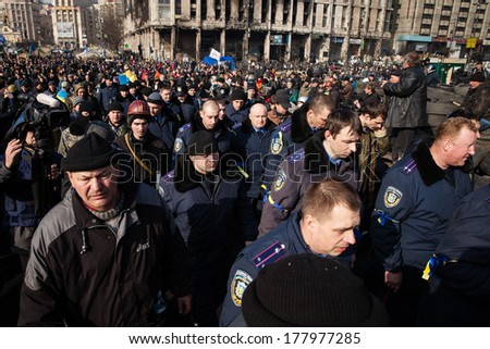 KIEV, UKRAINE - February 21, 2014: Police from Lviv swore allegiance Ukrainian people and arrived in Kiev, Ukraine to join and protect Euromaidan, activists and protesters. - stock photo