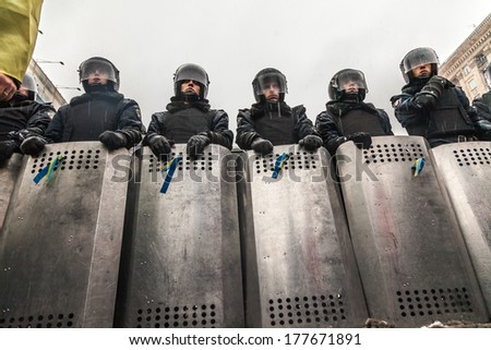 "KIEV, UKRAINE - 18 FEBRUARY: Protest against ""Dictatorship"" in Ukraine turns violent on Euromaydan in Kiev. Internal troops waiting rebel attack on 18 February, 2014 in Kiev, Maidan, Ukraine. - stock photo"