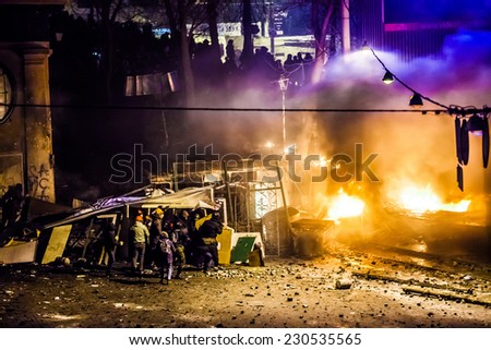 "KIEV, UKRAINE - 18 FEBRUARY: Protest against ""Dictatorship"" in Ukraine turns violent on Euromaydan in Kiev. Against the president Yanukovych on 18 February, 2014 in Kiev, Maidan, Ukraine. - stock photo"