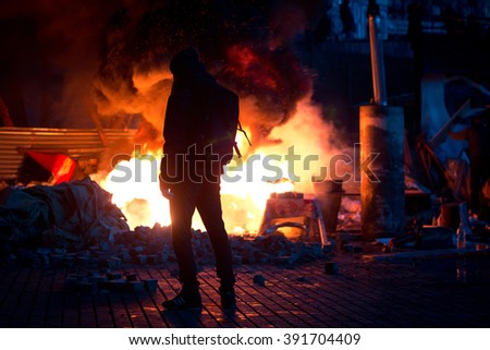 KIEV, UKRAINE February 18, 2014: Protesters set fire to barricades in Kyiv. The revolution in Ukraine