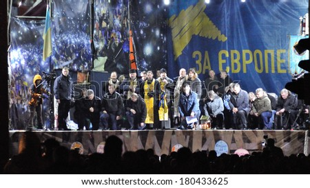 KIEV, UKRAINE - 22 FEBRUARY 2014: Ukrainian political leaders and new government stay on knees in the face of people on central square on February 22, 2014 in Kiev, Ukraine.  - stock photo