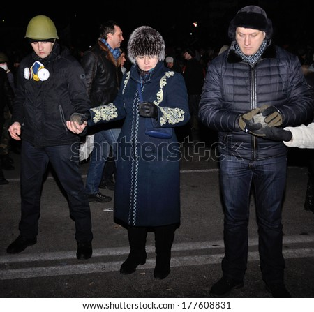 KIEV, UKRAINE � 18 FEBRUARY 2013: Unknown demonstrators prepare stones for fights with police on a barricade on Ukrainian revolution on February 18, 2013 in Kiev, Ukraine.