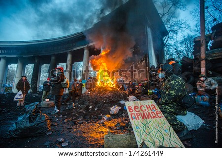 KIEV, UKRAINE - JAN 26, 2014: Euromaidan protesters rest and strengthen their barricades on Hrushevskoho Street after another night of clashes with riot police in Kiev, Ukraine. - stock photo