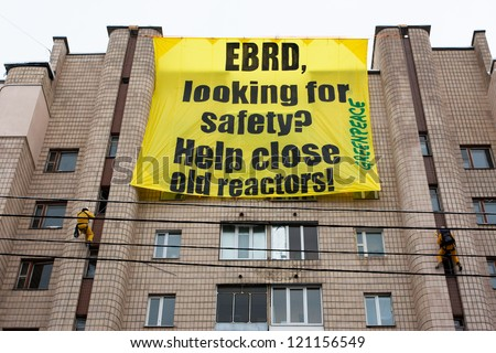 KIEV, UKRAINE - JAN 7: Greenpeace activists in radiation protection suits urges bank EBRD not to loan to Ukraine for building new nuclear reactors in Rivne & Khmelnytsky on January 7, 2012 in Kiev