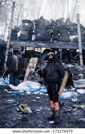 KIEV, UKRAINE - JAN 26, 2014: Mass anti-government protests in the center of Kiev. Euromaidan protesters rest and strengthen the barricades after night of clashes with riot police