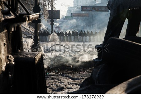 KIEV, UKRAINE - JAN 26, 2014: Mass anti-government protests in the center of Kiev. Government troops guarding the government district