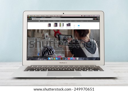 KIEV, UKRAINE - JANUARY 29, 2015: Brand new Apple MacBook Air Early 2014 with page presenting new iPad Air 2 on screen, designed and developed by Apple Inc., it was released on April 29, 2014 - stock photo