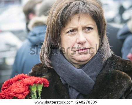 KIEV, UKRAINE - January 29, 2015: Finance Minister Natalia Yaresko. Ukrainian politicinas attended the ceremony Kruty Heroesentered into an battle with Bolsheviks - stock photo