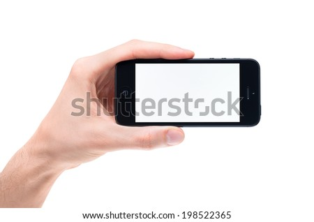 KIEV, UKRAINE - JANUARY 31, 2013: Hand holding a brand new black Apple iPhone 5 with blank screen. The new smartphone is sixth generation version of the iPhone line, was released on September 21, 2012 - stock photo