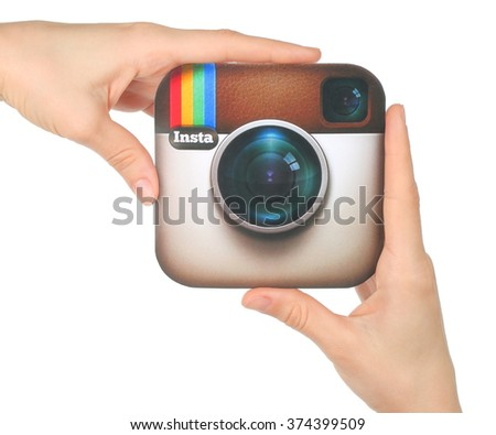Kiev, Ukraine - January 15, 2016: Hands hold Instagram logo printed on paper on white background. Instagram is an online mobile photo-sharing, video-sharing service