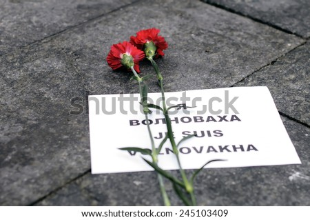 "Kiev, Ukraine - January 18, 2015: mourning at the Independence Square for the victims of the bus on the highway Volnovakha, Donetsk region. ""Je suis Volnovakva"" demonstration - stock photo"