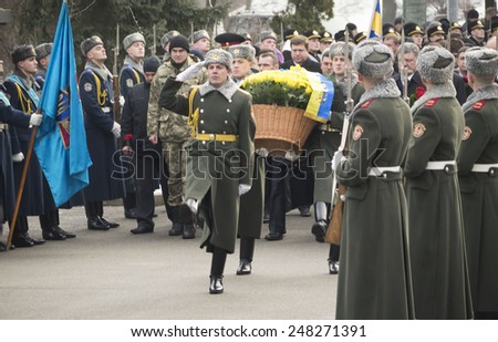 KIEV, UKRAINE - January 29, 2015: Politicians pass Guard of honor. Ukrainian politicinas attended ceremony Kruty Heroes, young guys who on this day in 1918 near the station Kruty in Chernihiv region  - stock photo