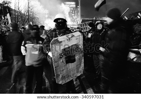 "KIEV, UKRAINE - January. 21, 2014 :  Protest against ""Dictatorship"" in Ukraine turns violent on Euromaydan in Kiev.  - stock photo"