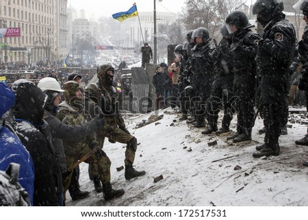 "KIEV, UKRAINE - 21 JANUARY: Protest against ""Dictatorship"" in Ukraine turns violent on Euromaidan in Kiev. Against the president Yanukovych on 21 January, 2014 in Kiev, Maidan, Ukraine - stock photo"
