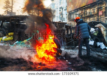 KIEV, UKRAINE - JANUARY 24: Protester at Hrushevskogo street on January 24, 2014 in Kiev, Ukraine. The anti-governmental protests turned into violent clashes during last week.