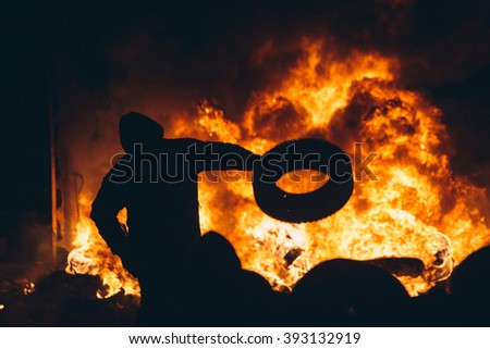 Kiev, Ukraine - 23 January, 2014: Protester burn tires to stop the riot police, because Ukrainian police want to storm the main anti-government protest camp in the Kiev. During revolution in Ukraine. - stock photo